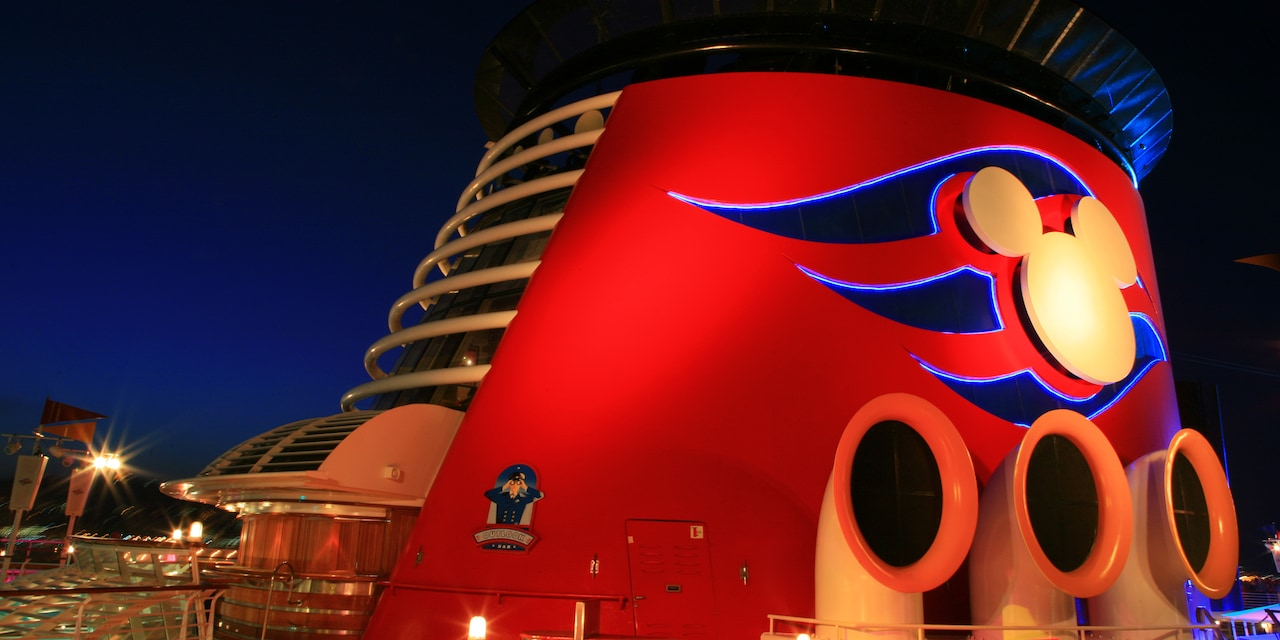 The funnel of the Disney Magic cruise ship with a Mickey Mouse logo