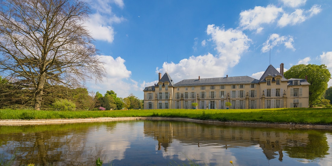 The French castle, Chateau Malmaison, sits just beyond a nearby pond