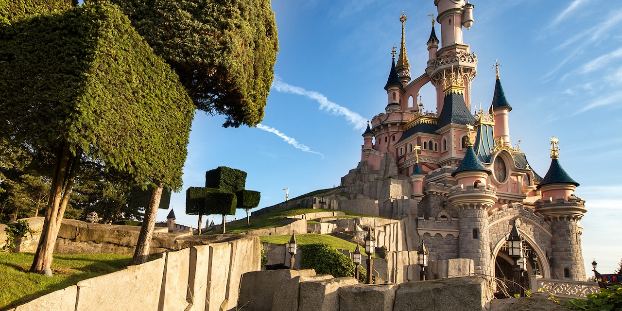 Rectangle-shaped topiary trees outside Sleeping Beauty Castle in Disneyland Park at Disneyland Paris