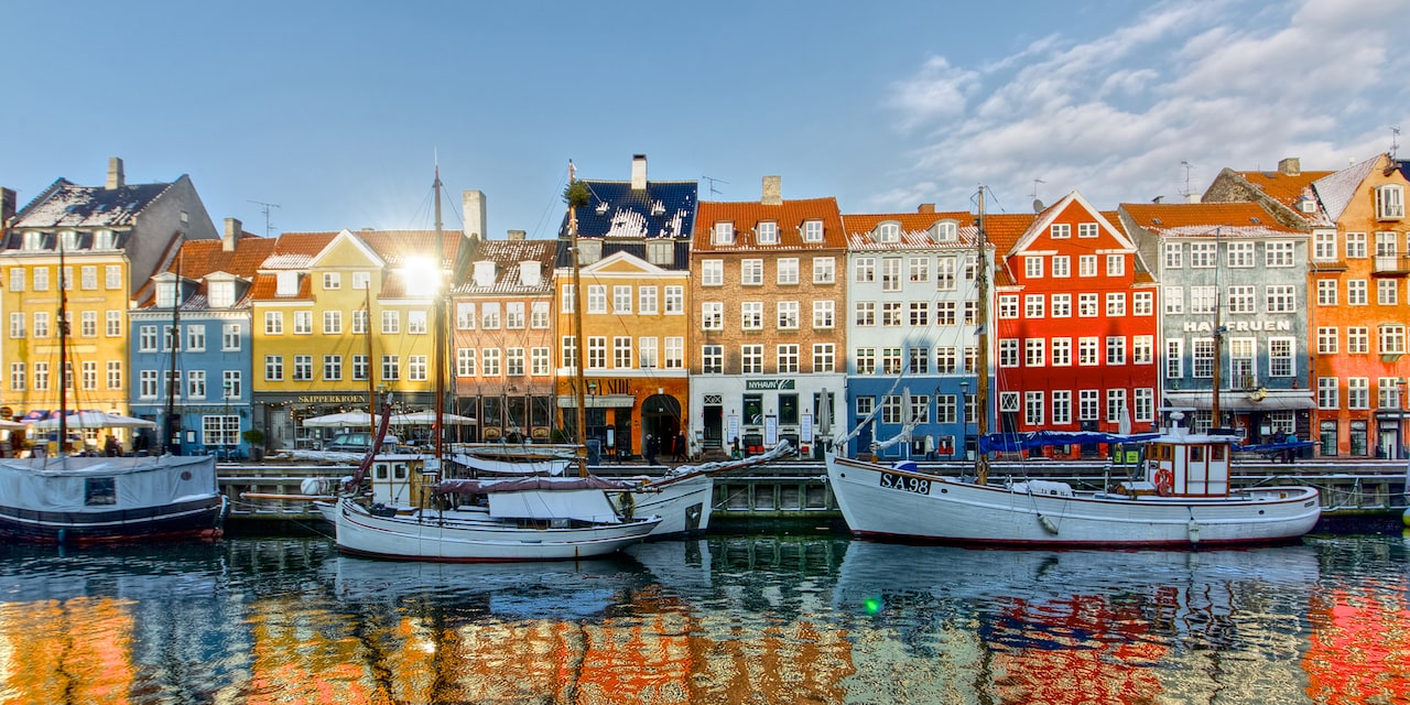 Boats docked along the shoreline of Copenhagen