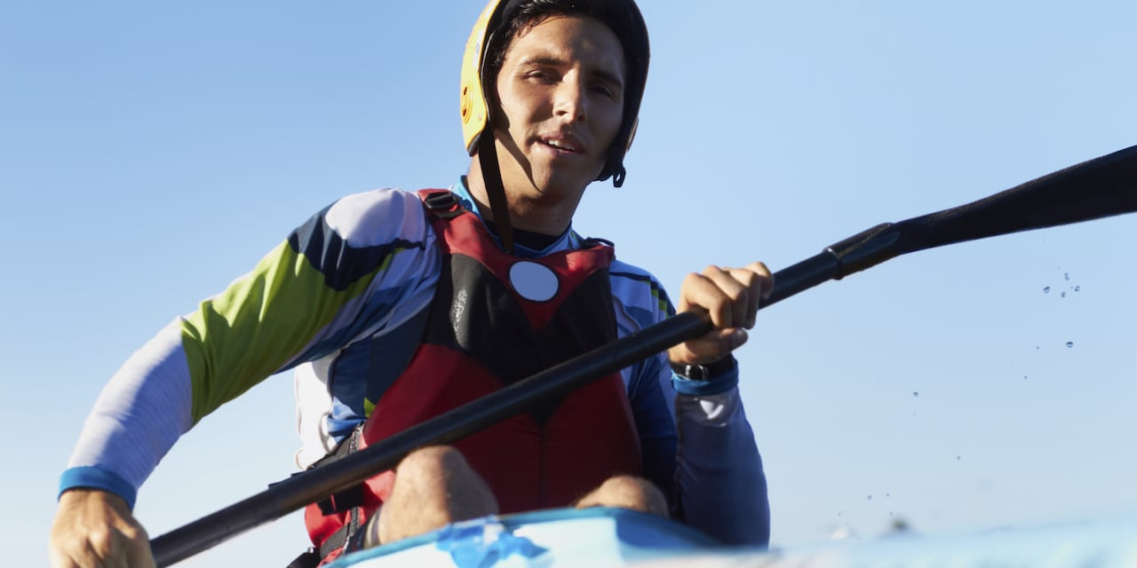 A young man kayaks