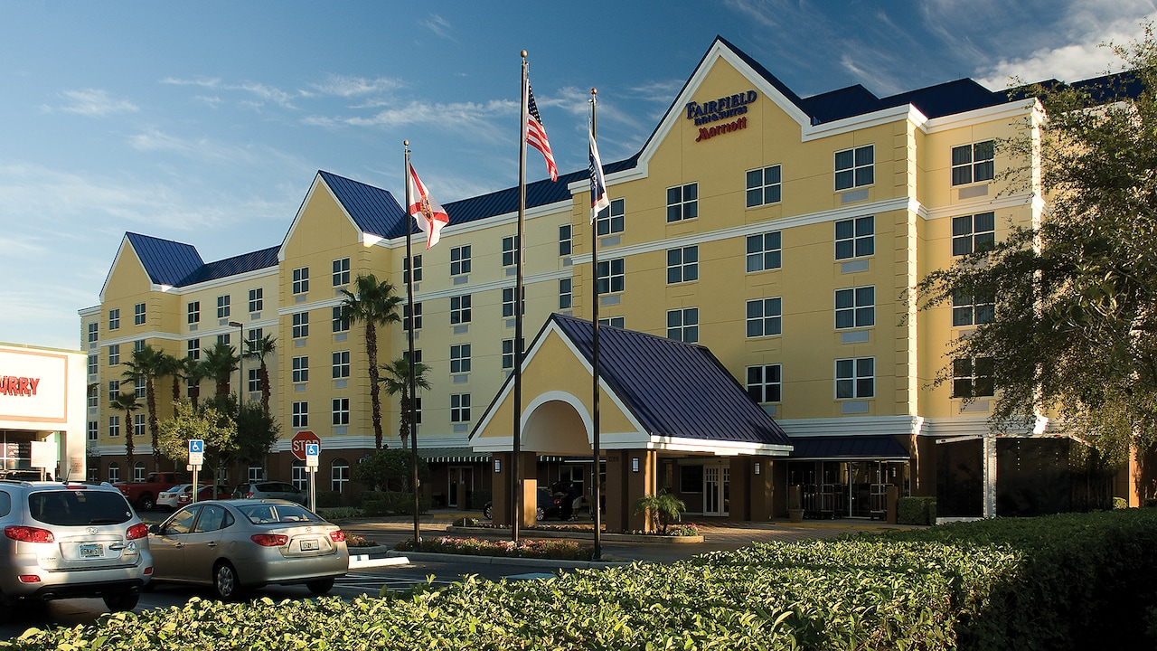 The exterior of the Fairfield Inn and Suites by Marriott, with its driveway and manicured hedges
