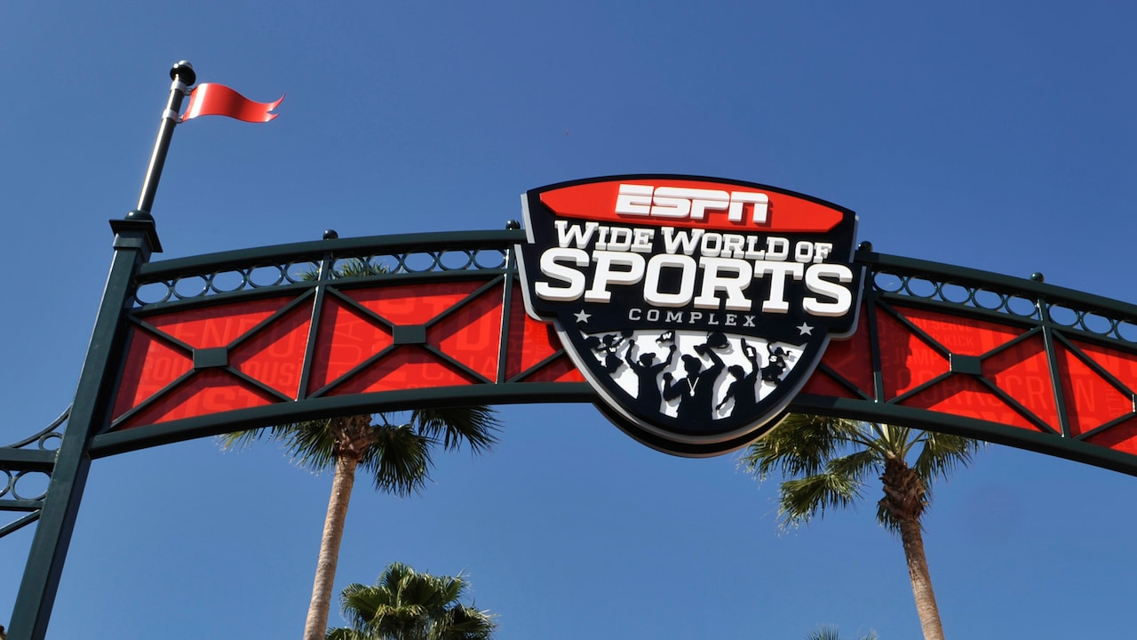 A large, overhead sign that reads E S P N Wide World of Sports Complex