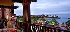 A couple peers over the balcony at Ko Olina Beach