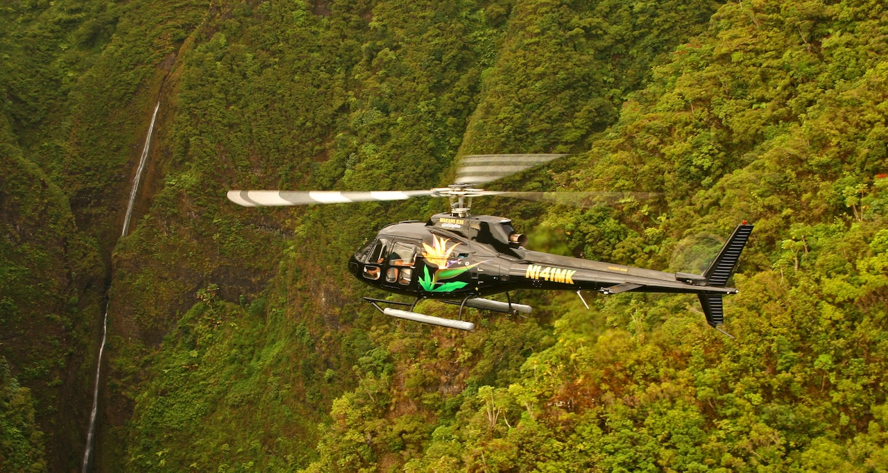 A chopper flys over the central plains of Oahu