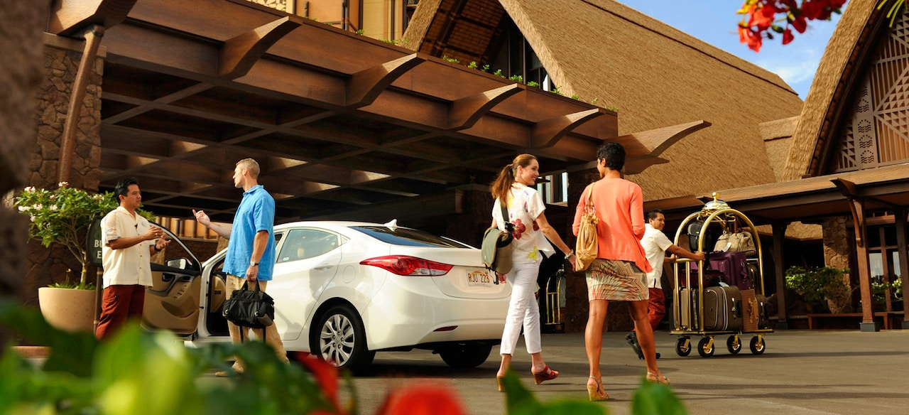 Guests using valet and bell services at Aulani