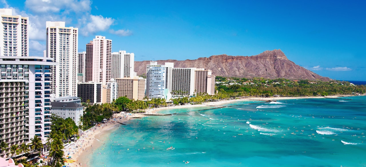 Oceanfront resort hotels lining Waikiki Beach, with Diamond Head visible beyond