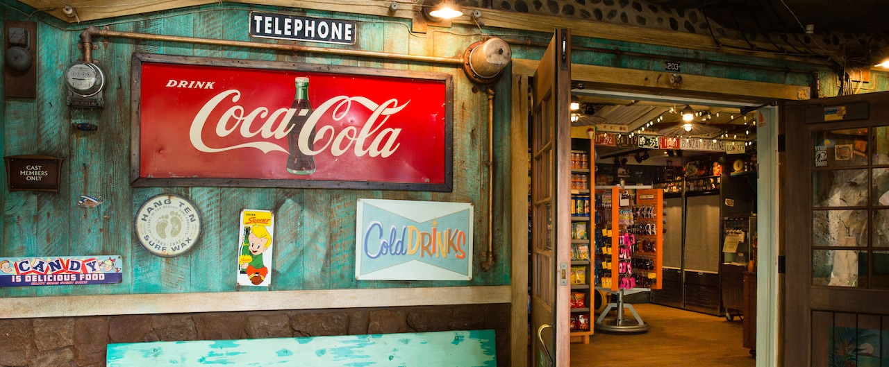 The exterior of Lava Shack snack shop, featuring weathered paint and vintage style product signs
