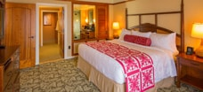 The bedroom of a 1-bedroom suite at Aulani