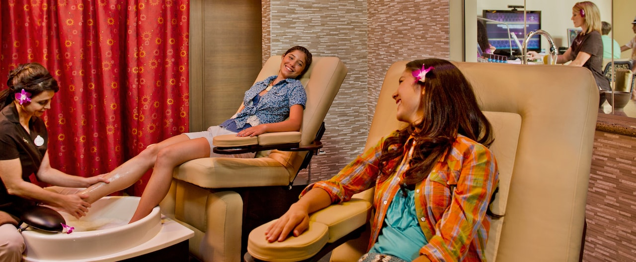 Two teen girls get pedicures at Painted Sky teen spa