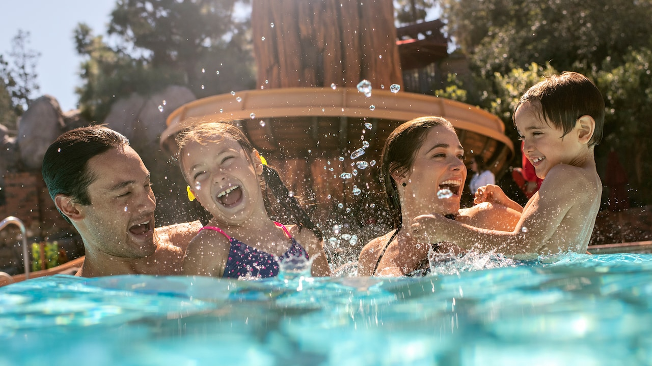 A mother and son splash around the pool at Disney's Grand Californian Hotel and Spa