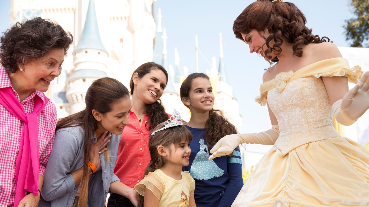 Excited Guests meet Belle in front of Cinderella Castle at Magic Kingdom park