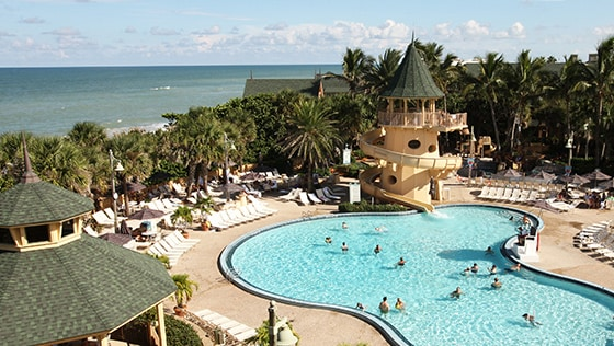 The pool at Disney's Vero Beach Resort in Florida with the Atlantic Ocean in the background
