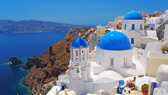 The blue domes of Santorini, Greece along the Mediterranean Sea