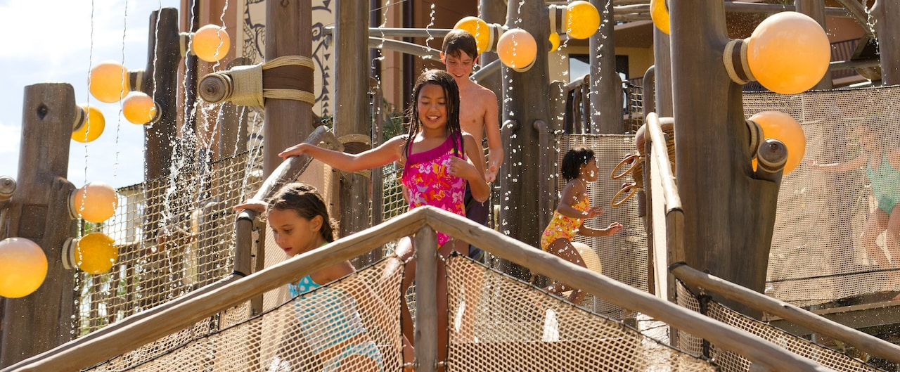 Kids of all ages laugh and play while they make their way across the Menehune Bridge play area