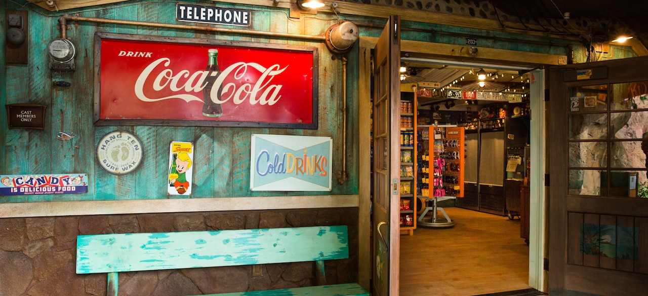 The exterior of Lava Shack snack shop, featuring weathered paint and vintage-style product signs