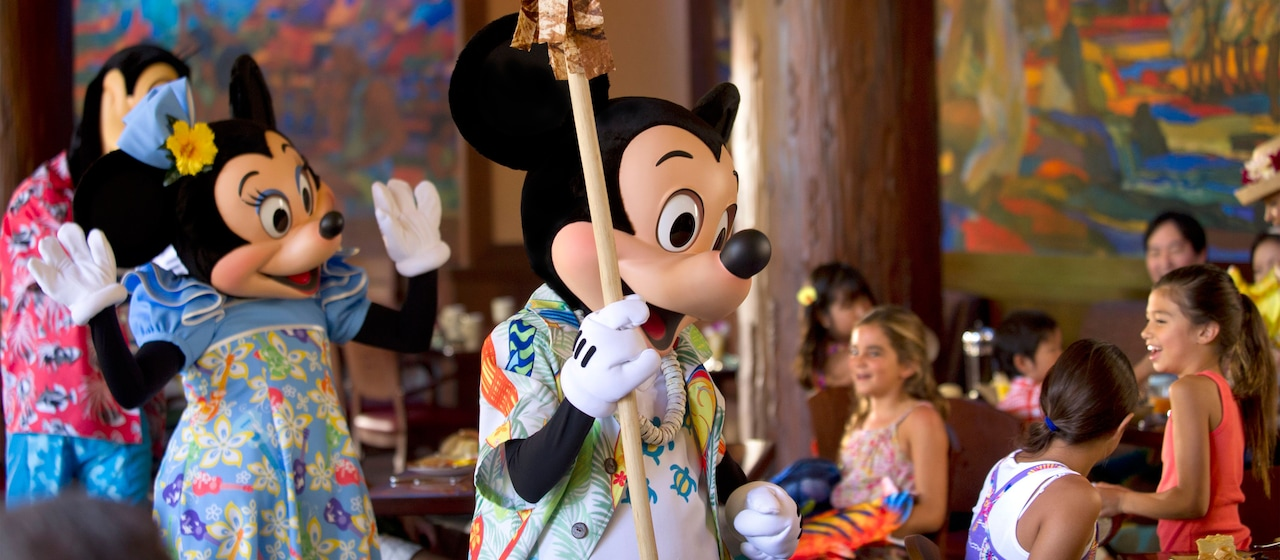 Mickey and Minnie interact with several young diners during breakfast