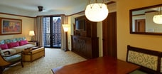 The living area and balcony of a 1-bedroom villa at Aulani