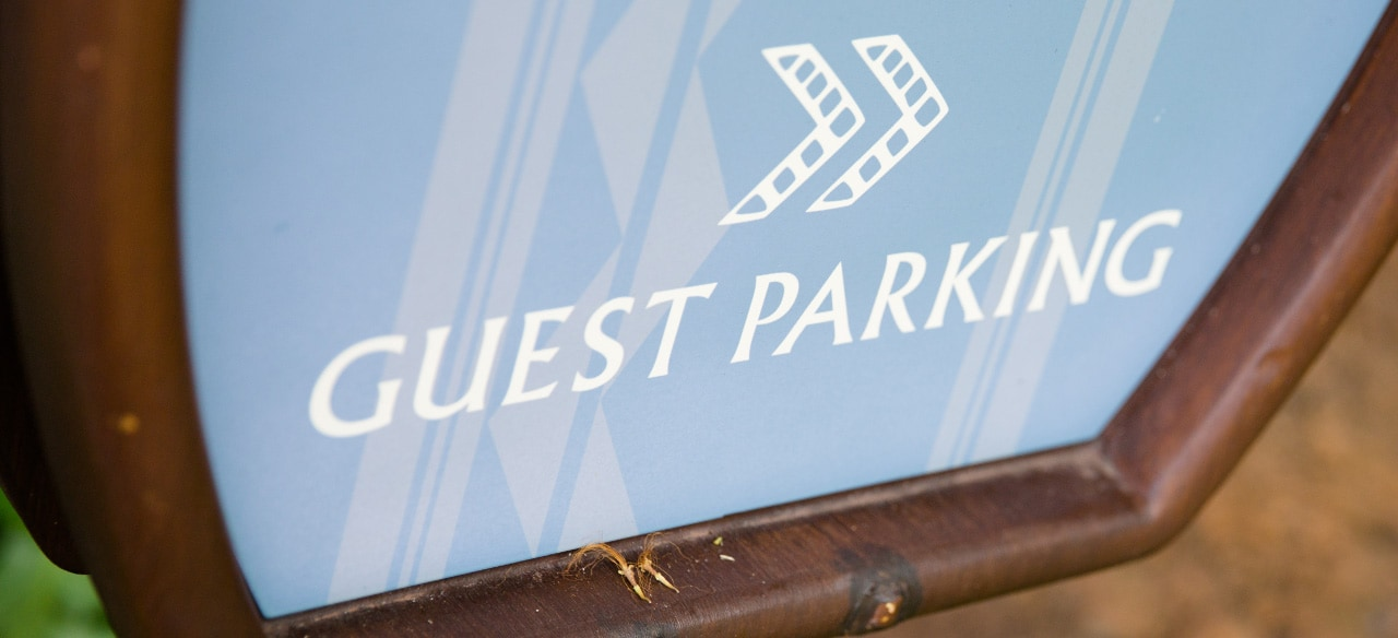 A sign directs Guests to Guest Parking
