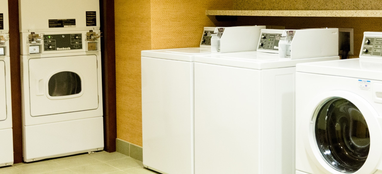 The laundry room at Aulani contains multiple washing machines and dryers