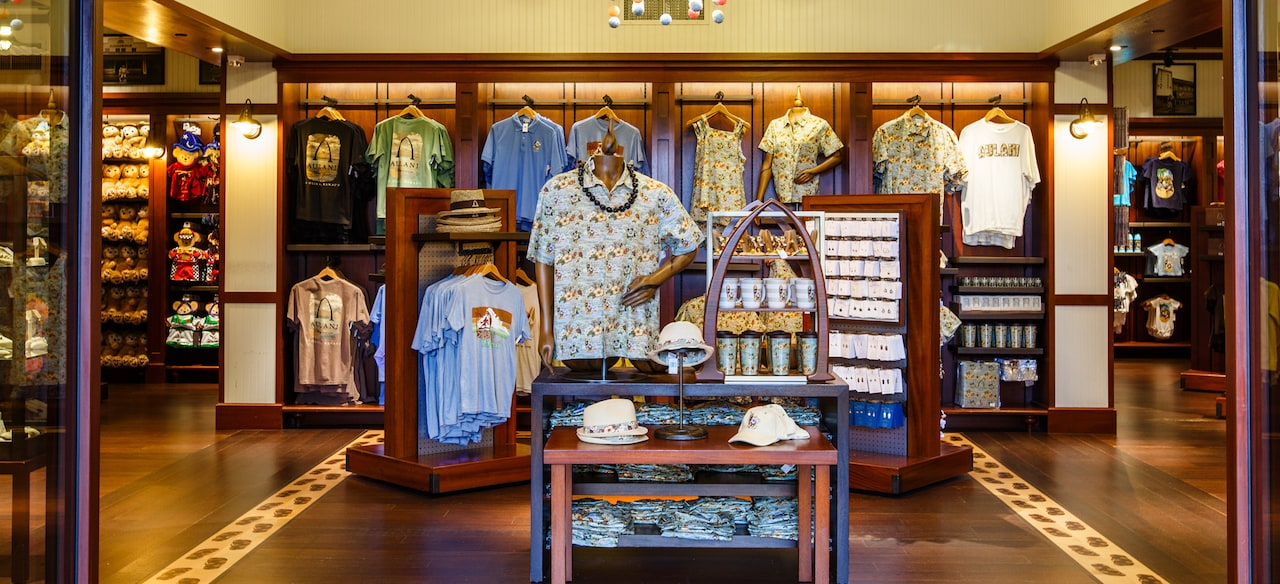 Disney-themed resort wear, mugs and jewelry displays inside Kalepa's Store, the Aulani lobby gift shop