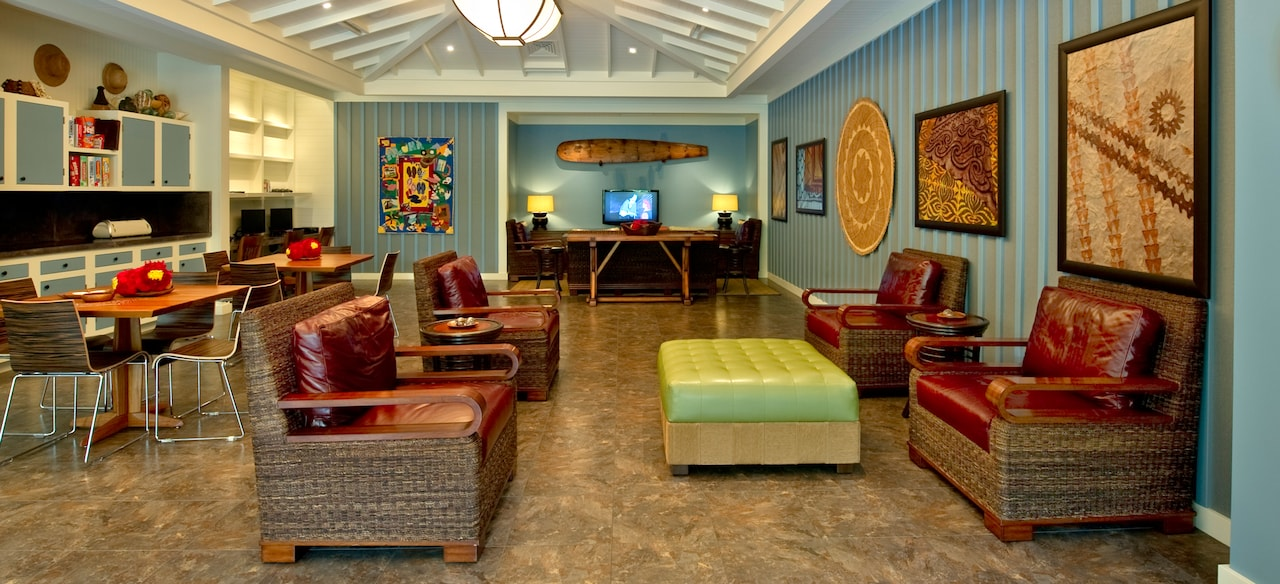 Four armchairs, an ottoman, 2 activity tables and a TV room at the Pau Hana community hall