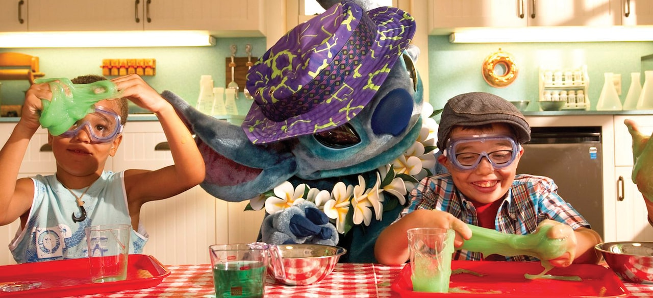 Stitch watches two kids play with goo-part of the fun captured by Aulani Photographers