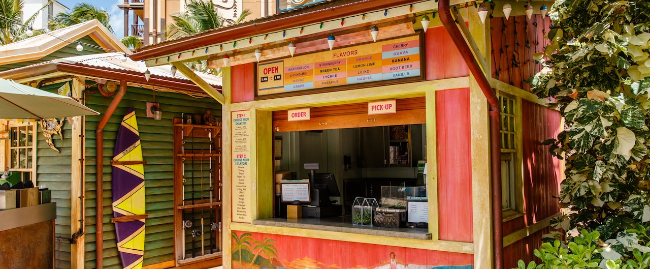 The exterior of Papalua Shave Ice, showing the menu board, ordering instructions and walk up window