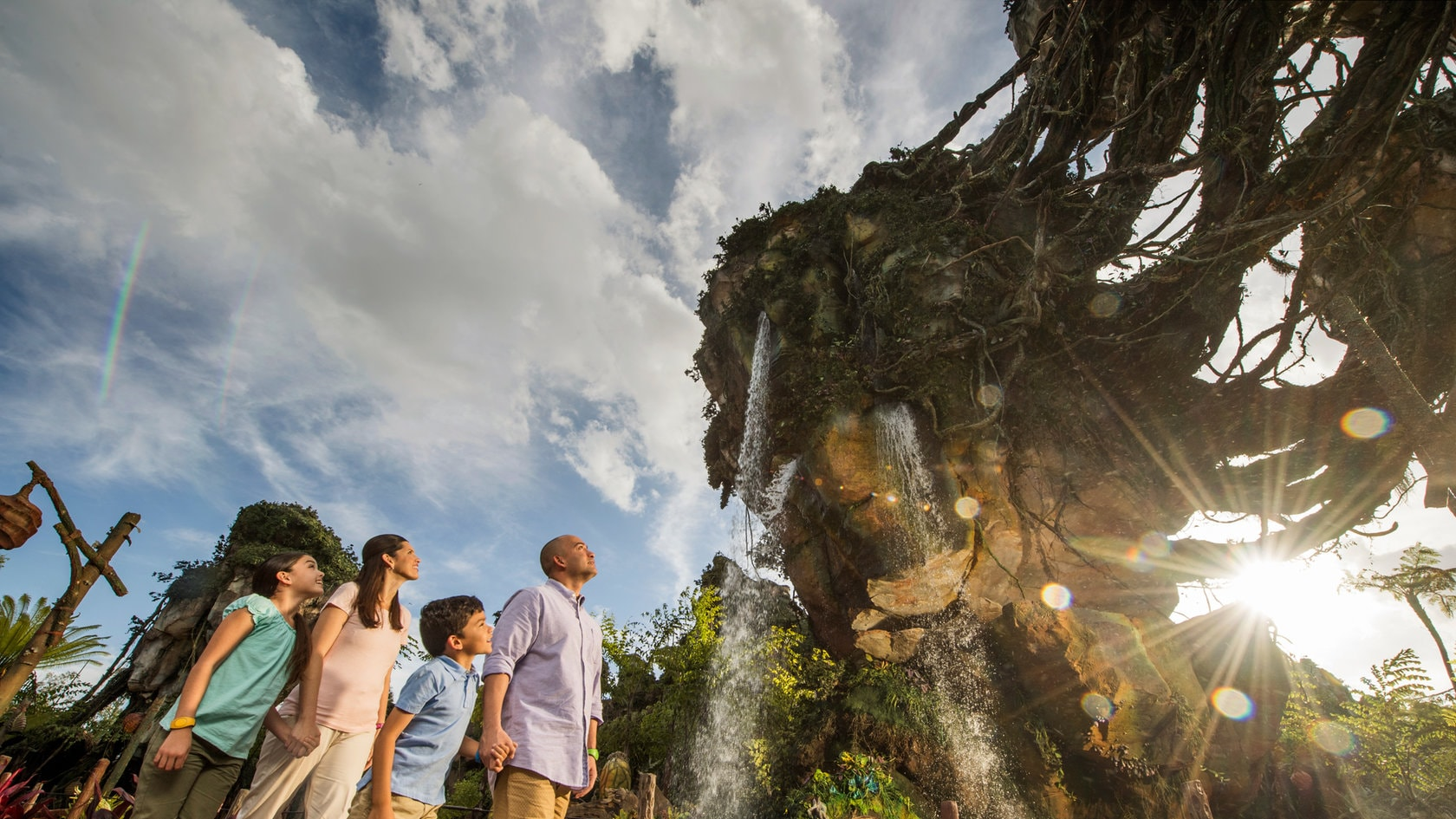 family vacations at disney parks resorts a family of 4 gazing in wonder at the majestic floating mountains of pandora the