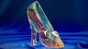 Clear crystal Cinderella slipper adorned with diamond and topaz pendant