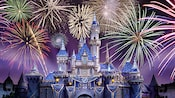 Vibrant fireworks bursting above Sleeping Beauty Castle at the Disneyland Resort Diamond Celebration.