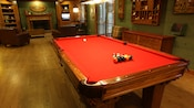 A pool table in Big Murggie's Den at The Live Oak Lodge