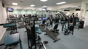 Disney's Vero Beach fitness room with workout equipment, mirrored walls and TVs