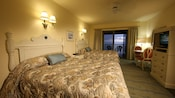 Deluxe Studio with 2 queen beds, TV armoire, table and doors leading to the balcony with ocean view