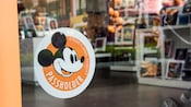 A window to a gift shop with a decal that reads Disneyland Resort Passholder