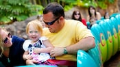 Parents and their young daughter enjoy a relaxing ride on Heimlich's Chew Chew Train