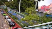 Ready to roll, Honda's newly renovated Autopia cars are lined up along the attraction's tree lined tracks