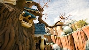 Chip 'n' Dale Treehouse sits within twisted oak tree branches dotted with acorn buds