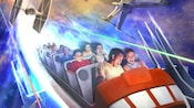 Guests hold on tight as they soar through Hyperspace Mountain.