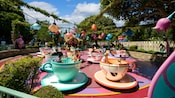 Many giant Mad Tea Party teacups whirl in circles to Guests' delight