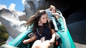 Teen girls hold on tight in a Matterhorn Bobsled