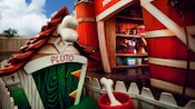 Pluto's dog house near Mickey's movie barn