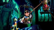 An incredulous Jiminy Cricket points to Pinocchio's incredibly long nose