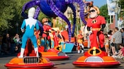 The Incredibles' family ride hover crafts to escape the evil Omnidroid in this popular parade