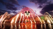 World of Color water jets point to Mickey's Fun Wheel