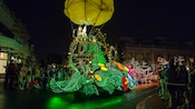 Tinker Bell greets Guests from atop her nature-themed float