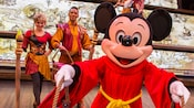 Sorcerer Mickey with paint buckets and 2 Mickey and the Magical Map performers