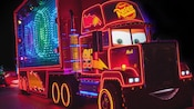 Mack from the Disney•Pixar series 'Cars' lit up with vibrant effects in the Paint the Night parade