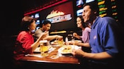 Friends take a break from the ESPN Zone Sports Arena games for food from the ESPN Zone restaurant