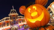 An oversized Mickey inspired jack o lantern decorates Main Street, U.S.A.
